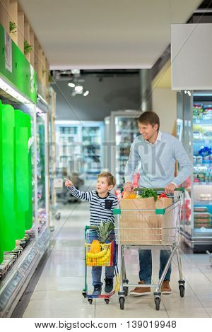 Dad and son with shopping cart