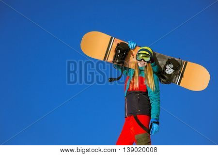 Active woman with snowboards