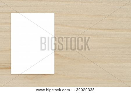 Blank folded paper poster hanging on wooden wallTemplate mockup for adding your design.