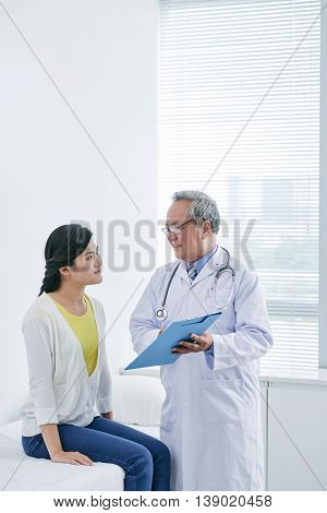 Experienced doctor explaining prescription to his patient