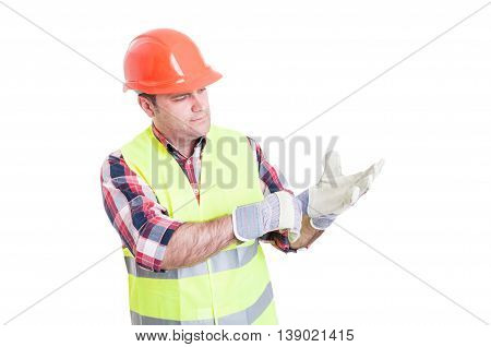 Attractive Constructor Adjusting His Gloves