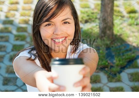 Beautiful Lady Smiling And Offering Takeaway Coffee Cup