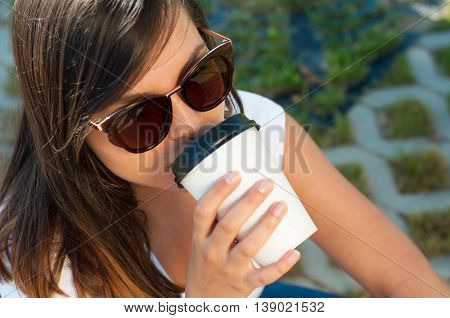 Beautiful Woman Sipping From Coffee Cup Outside