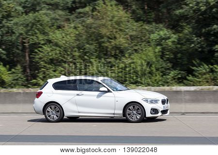 FRANKFURT GERMANY - JULY 12 2016: White BMW M1 Coupe on the highway in Germany