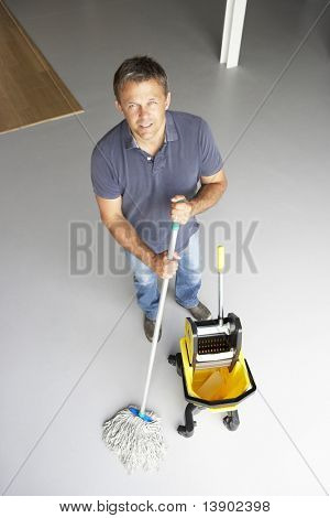 Cleaner mopping office floor