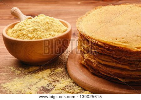 Stack of gluten free pancakes made from corn flour .