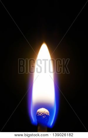 Burning match isolated on a black background