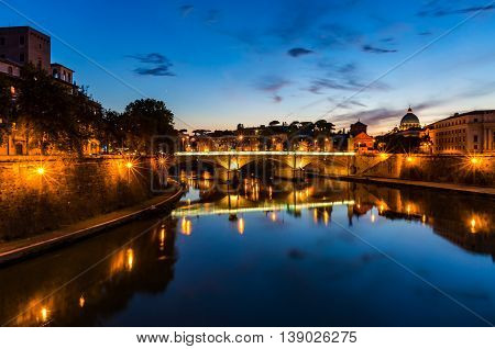 Castle Saint Angel and bridge over the Tiber river on sunset. Night cityscape of Rome landmarks with copy space. Italy