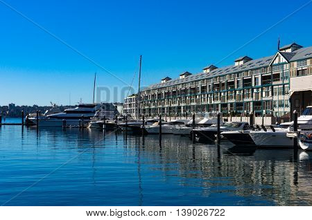Woolloomooloo bay with historic Finger wharf which is the longest timbered-piled wharf in the world. Sydney Australia