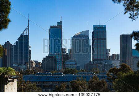 Fingers wharf with Sydney Business District skyscrapers on sunny day