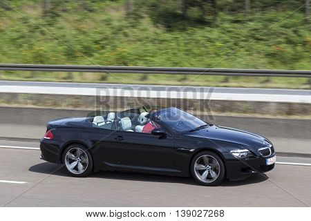 FRANKFURT GERMANY - JULY 12 2016: Black BMW M6 Convertible on the highway in Germany