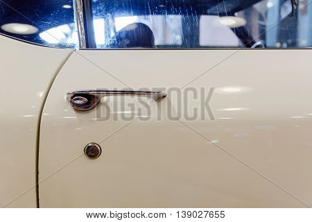 old car door handle white lock and the door edge