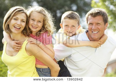 Family relaxing in countryside