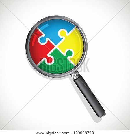 a magnifying glass on a multi coloured jigsaw