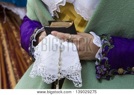 CAGLIARI, ITALY - May 1, 2015: 359 ^ Religious Procession of Sant'Efisio - Sardinia - details of a lace handkerchief handheld by a girl in traditional Sardinian costume