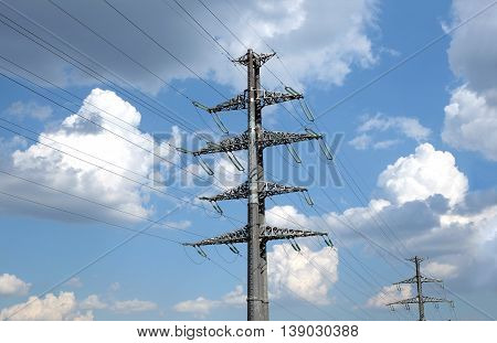 High-voltage power line gray metal prop with many wires vertical view