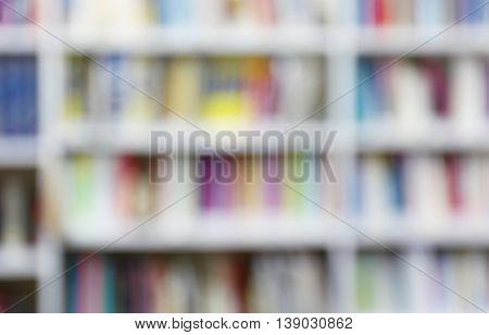 Modern library. Bookshelves full of books, unfocused