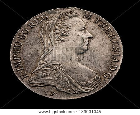 Maria Theresa silver thaler isolated on black angle shot