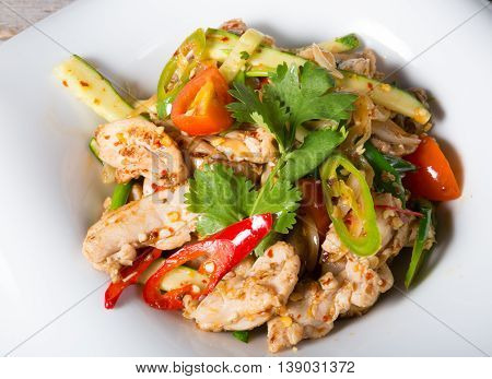 Asian stir-fried chicken with vegetables and spices
