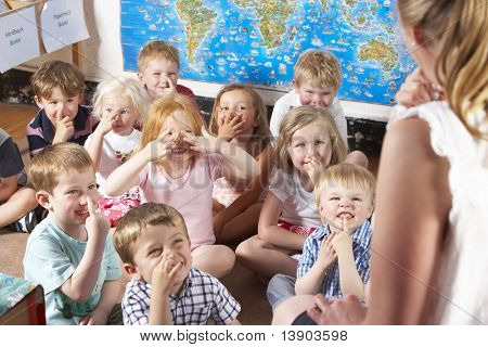 Montessori/Pre-School Class Listening to Teacher on Carpet