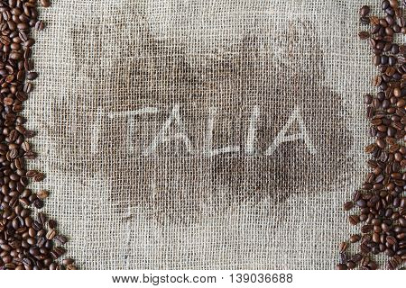 Burlap texture with coffee beans border. Sack cloth background with Italy title, word Italia in the middle. Brown natural sackcloth canvas. Seeds at hessian textile