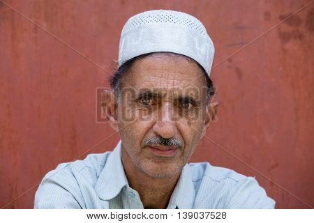 Portrait muslim man in Srinagar Kashmir India. Close up