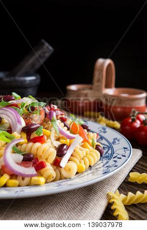 Mexican Pasta Salad With Red Bean, Corn, Tomato, Onion And Pepper