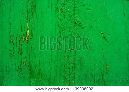 old wooden wall green background with cracked paint