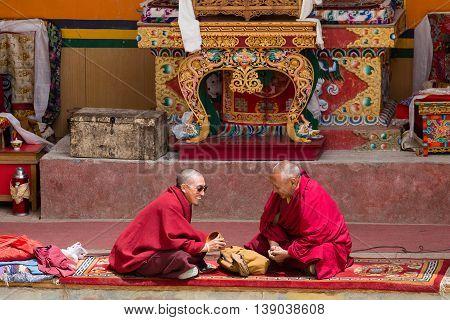 LAMAYURU INDIA - JUNE 13 2015: Unidentified two buddhist monk during mystical mask dancing Tsam mystery dance in time of Yuru Kabgyat Buddhist festival at Lamayuru Gompa Ladakh North India
