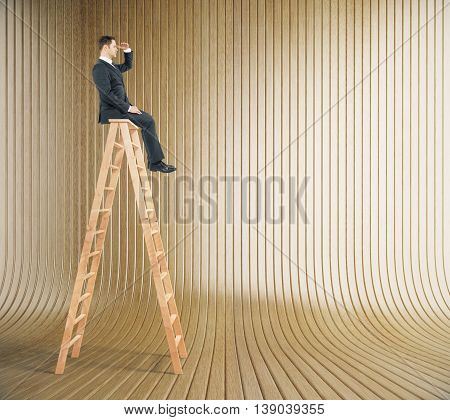 Research concept with businessman sitting on ladder top and looking into the distance on wooden plank background