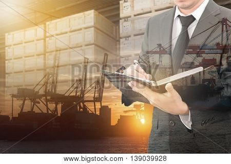 Businessman Writing Notebook With Blurred Cargo In Wooden Case And Transportation Port Background, T
