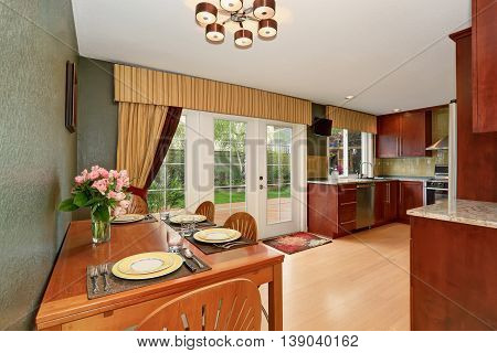 Kitchen Room Interior Connected With Dining Area With Deep Green Walls