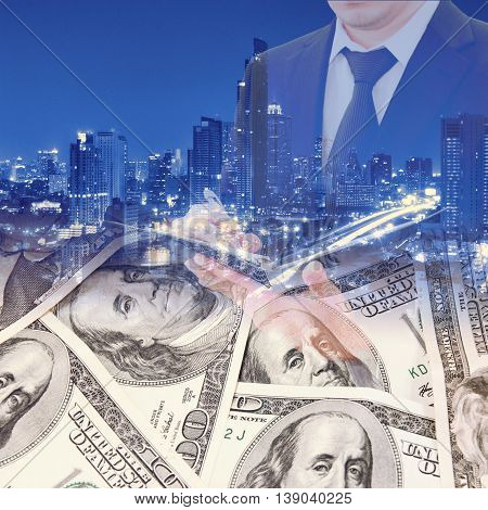 Double Exposure Of Businessman, Night City And Bank Dollar Notes For Busines Finance Concept