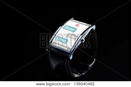 modern technology, online communication, object and media concept - close up of black smart watch with messenger application on screen