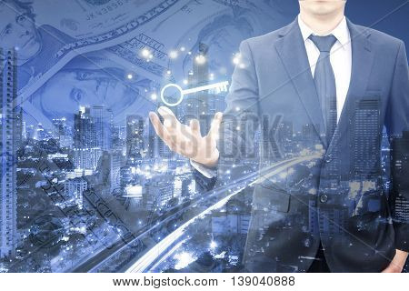 Double Exposure Of Businessman Showing Key Business To Sucess And City Center And Banking Dollar Pil