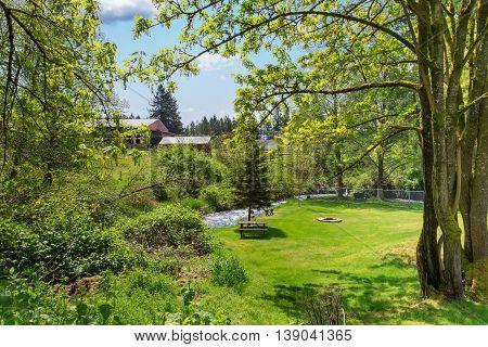 Mountain River View In Grassy Back Yard Of American Rambler