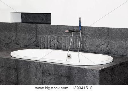 Modern white sink with black ceramic around, bathroom interior