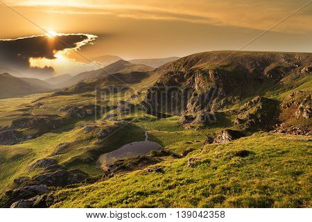 Mountain summer landscape / View from Transalpina highway at sunrise