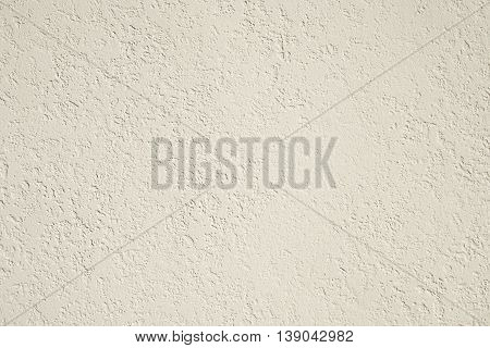 roughcast plaster wall background texture in off-white
