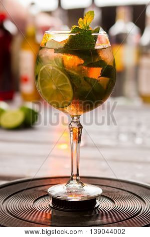 Drink with lime slice. Piece of fruit and mint. Make this evening special. Hugo cocktail with elderflower syrup.