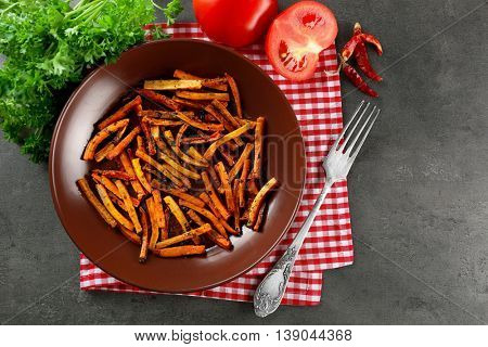 Sliced grilled carrots on a plate