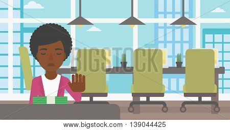 An african-american young business woman sitting at the table in office and moving dollar bills away. Vector flat design illustration. Horizontal layout.