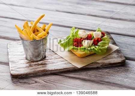 Bucket with fries and bread. Cream cheese and lettuce. Sandwich will have nice taste. Follow the proven recipe.