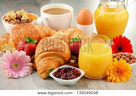 Breakfast Consisting Of Croissants, Coffee, Fruits, Orange Juice