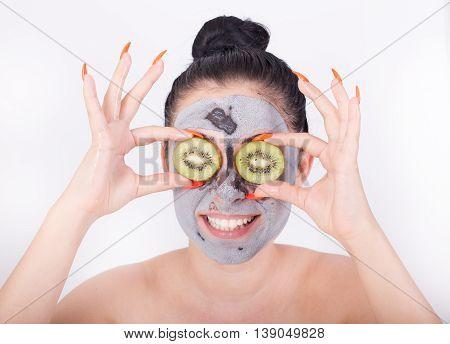 Girl With Facial Mask And Kiwi