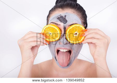 Girl With Facial Mask And Orange Slices