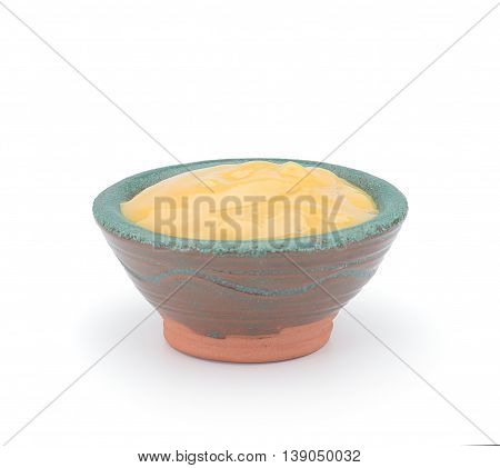 Mustard In A Clay Sauce-boat Isolated On White Background