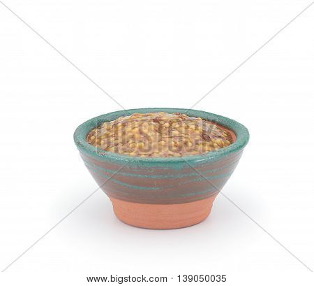 French Dijon Rough Mustard In A Clay Sauce-boat Isolated On White Background