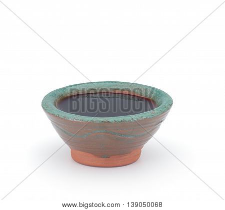 Soy Sauce In A Clay Sauce-boat Isolated On White Background