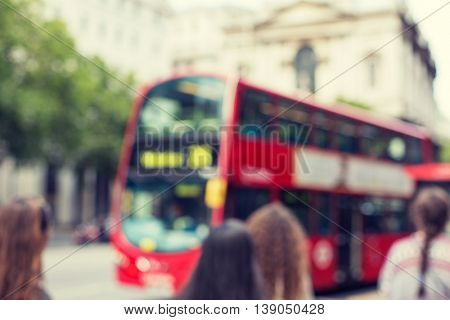 city life, backgrounds and transport concept - city street with red double decker bus in london